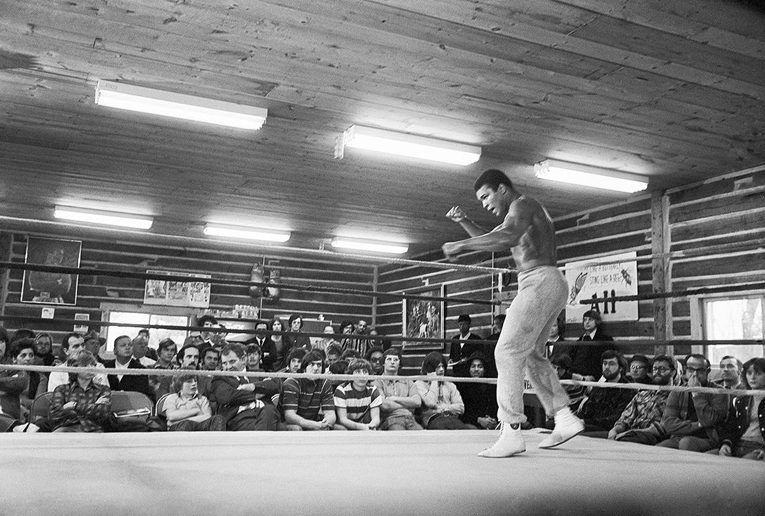 Muhammad Ali training with a boxing bag Photo Print
