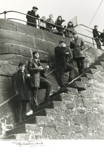 The Beatles on steps
