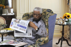 Nelson Mandela reading newspaper
