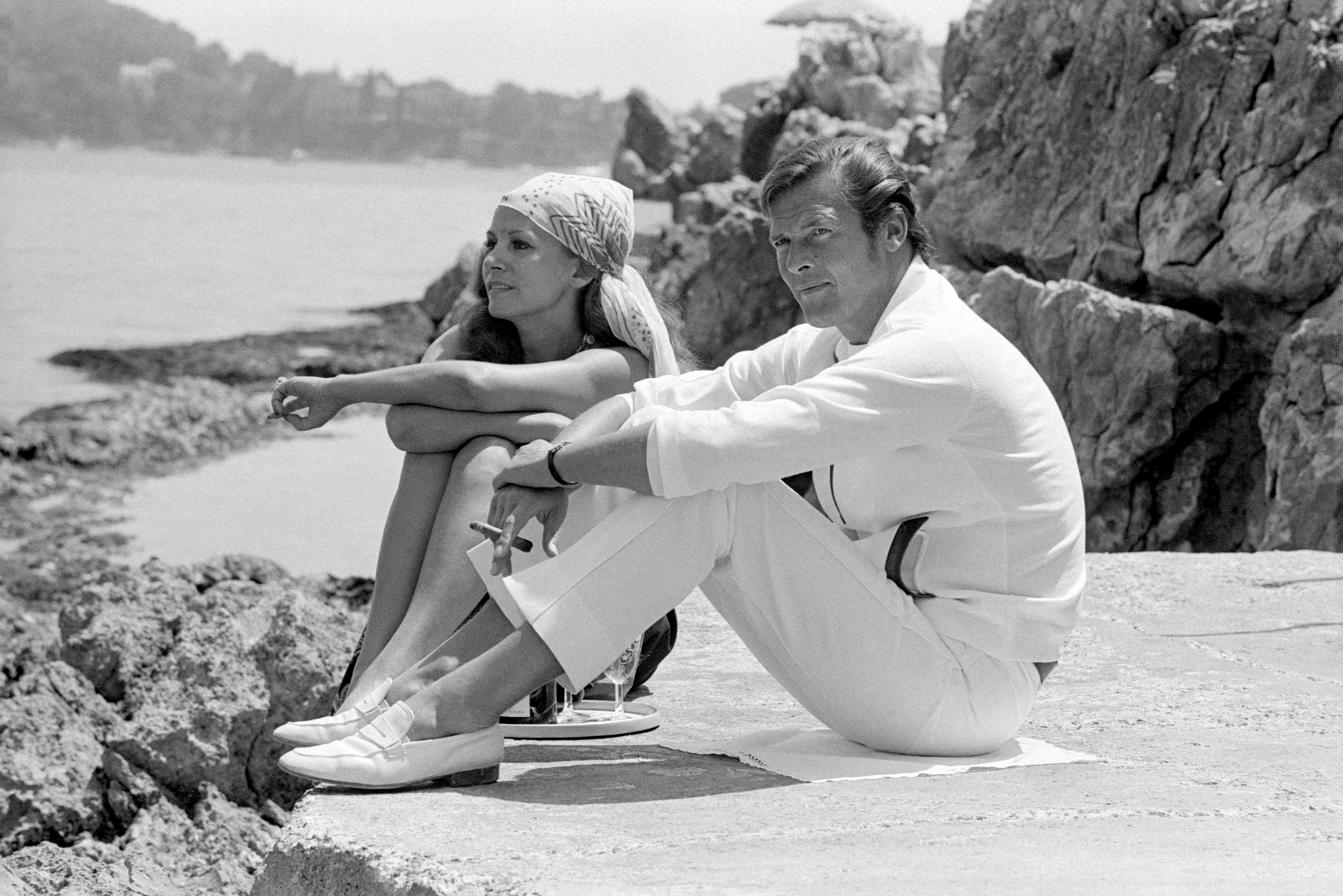 rm011 roger moore and luisa mattioli iconic images